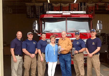 Buckley Security Service donated GoPro cameras to the Pearl Fire Department.